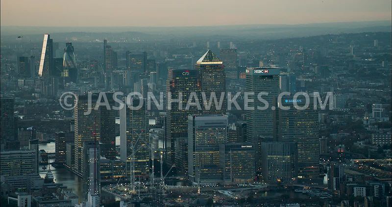 London Aerial Footage of Docklands with City skyline in background.