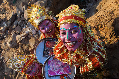 Girls dressed up to make money by having tourists take their photo during the Pushkar camel fair, Pushkar, Rajasthan, India