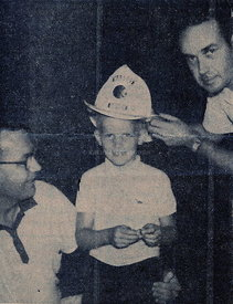 Jimmy_receives_helmet_at_firehouse