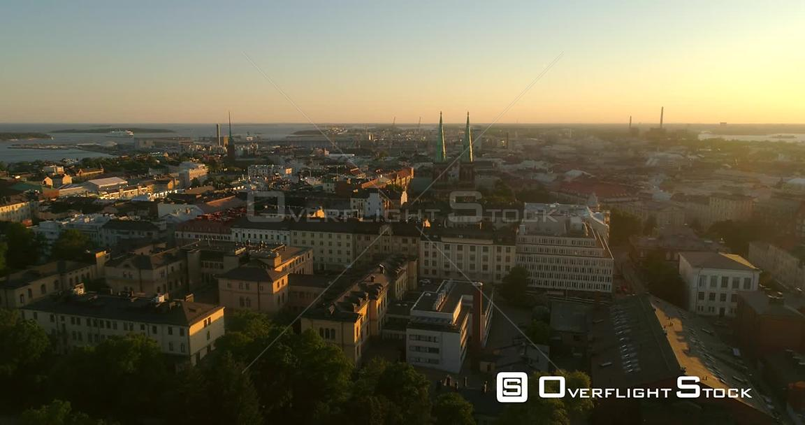 Helsinki Cityscape, Aerial Decreasing Tilt View of Punavuori and Saint John Church, in the City of Helsinki, on a Sunny Summer Evening Dusk, in Helsingfors, Uusimaa, Finland