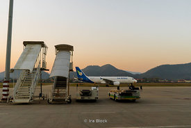 Sun setting over the international airport in Luangprabang, Laos.