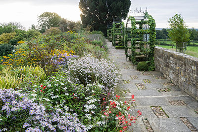 18th century raised walk with metalwork gazebos by Richard Overs being colonised by ivy gives views over surrounding countryside. Bourton House, Bourton-on-the-Hill, Moreton-in-Marsh, Glos, UK