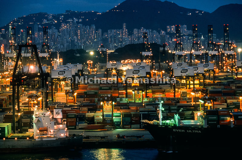 Lit up like a show window, a port displays goods risk-taking entrepreneurs sell the world at huge profits.  Hong Kong, China.