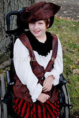 Girl in a wheelchair dressed up for Halloween