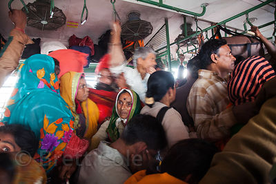 Pilgrims crowd a train heading south from Sealdah station in Kolkata, India to Kakdwip station near Sagar Island, for the Gangasagar Mela.