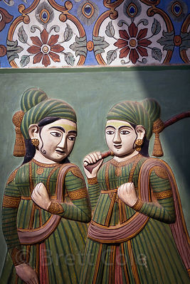 Colorfully painted relief carvings in the Jaipur City Palace, Rajasthan, India