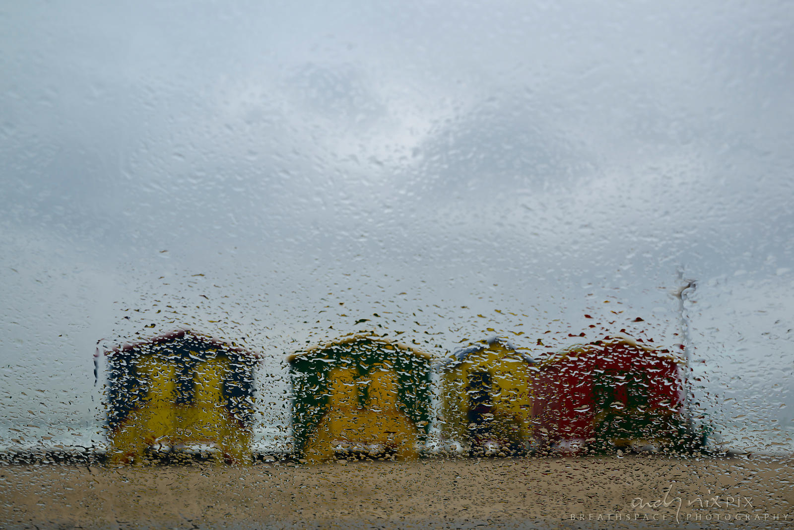 Beach huts in rain
