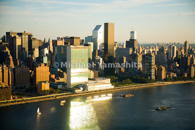 Midtown, along the East River, is a modernist vision, with the Secretariat of the United Nations, Citigroup Center and Trump World Tower reflecting the rising sun.  Manhattan, New York City.