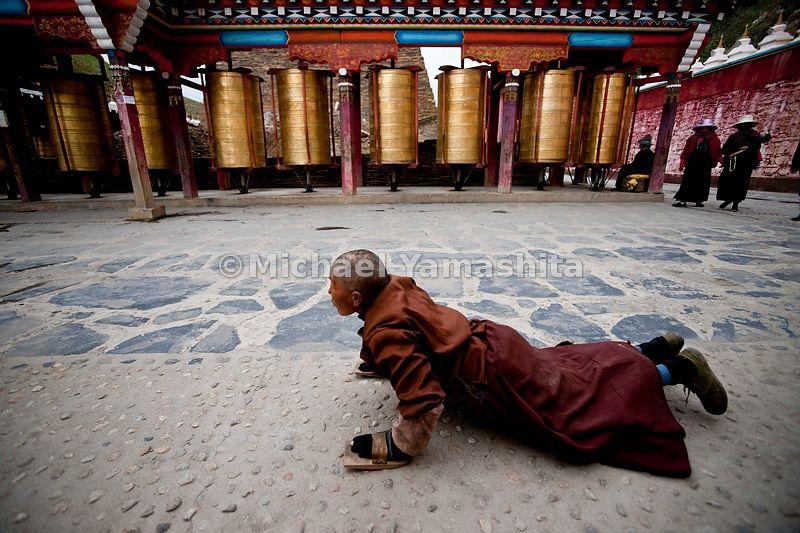 Segyagu, the faithful doing Kora and turning prayer wheels at this meditation center with it's huge mani stone monument nearby Lhagong monastery......................................
