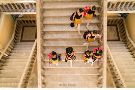 Students descending a staircase at the Cuban National Ballet School in Havana, Cuba.  There are approximately 3,000 students and it is the biggest ballet school in the world.