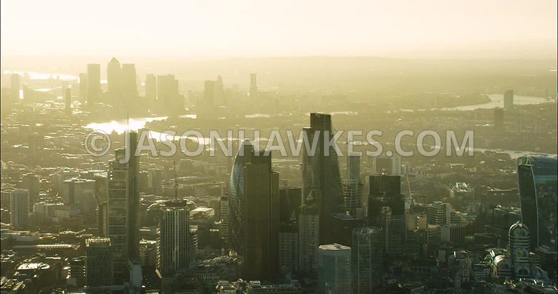 London Aerial Footage of City of London skyline towards Dockland and Canary Wharf.