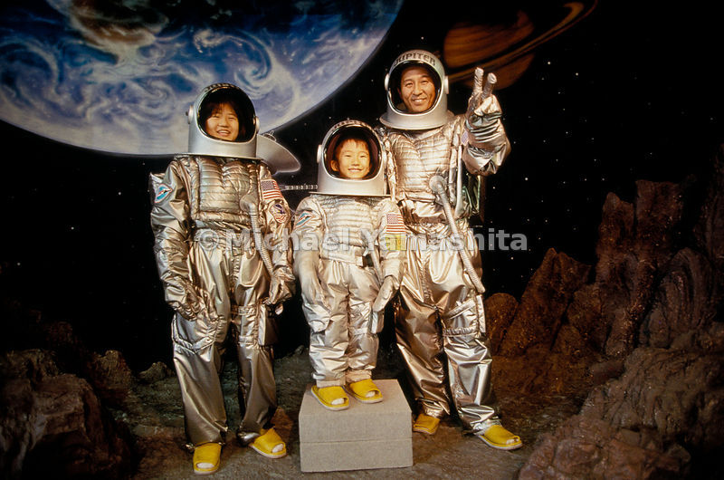 A successful lunar landing pleases a father and his children posing for a snapshot at Space World in Kitakyushu. The theme park trades on Japan's infatuation with space, especially keen in Kyushu, home of the nation's two launch sites.