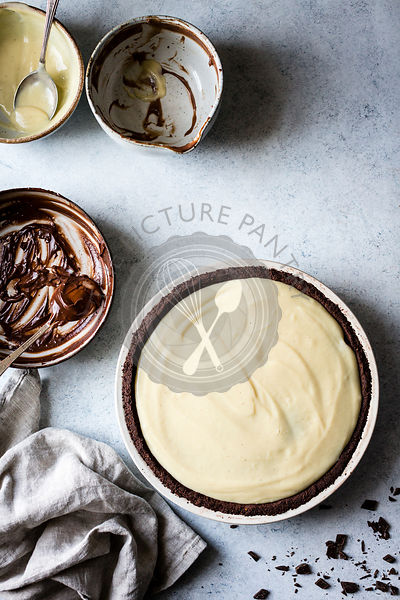 A chocolate pie base filled with melted milk and white chocolate