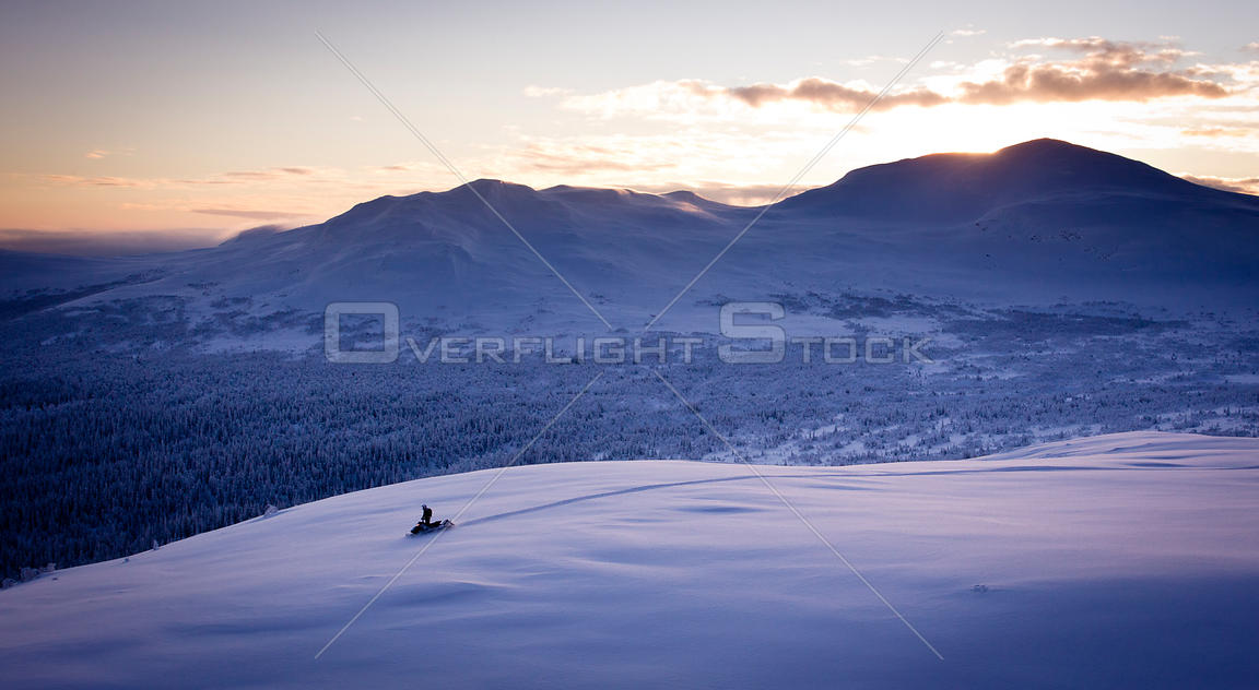 Snowmobile in mountain landscape, Sweden.