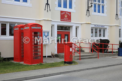 Stanley Post Office and Philatelic Bureau, housed in the Town Hall (1950), with British-style red telephone boxes and post box, Ross Road, Stanley, East Falkland, Falkland Islands