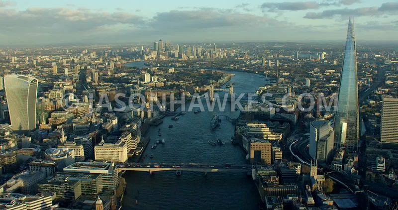 Aerial footage following the River Thames from Cannon Street Railway Bridge to Tower Bridge