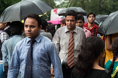 Businessmen in monsoon rains, Newmarket, Kolkata, India