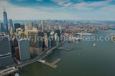 Aerial view across Manhattan showing Brooklyn Bridge and Manhattan Bridge