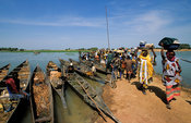 Djenné is situated on an island in the Niger Inland Delta. On market day many villagers cross the water from surrounding villages by pirogue, Mali