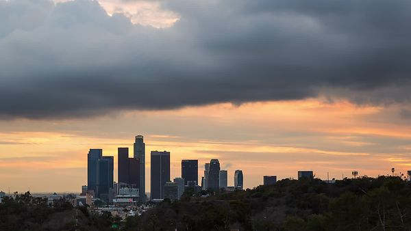 Medium Shot: Misty Marine Layer Clouds Rolling In Over A View of Downtown L.A. From Elysian Park (Day To Night)
