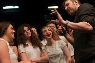 UK - Hull - Director Jamie Beale shows drama students from Hull University footage of their performance on his cellphone during rehearsals for the forthcoming production of Cycle Song in the Gulbenkian Theatre