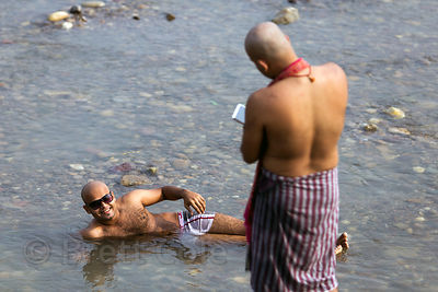 A man poses for a photo in the Ganges River, Haridwar, India