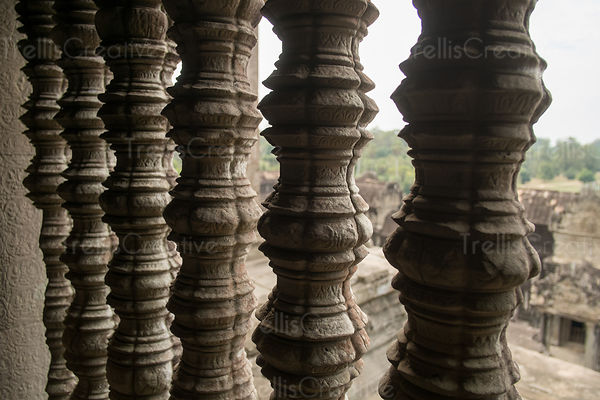 Close-up of carved stone columns at temple in Angkor Wat, Cambodia