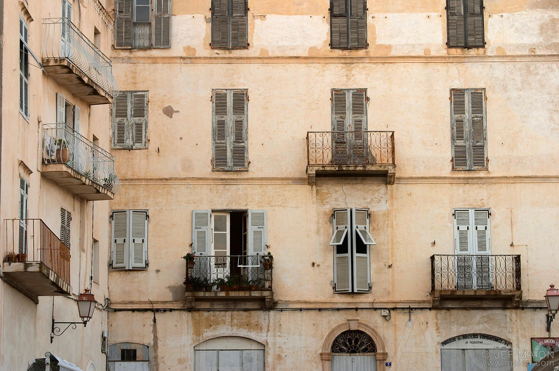 Pattern of old windows and balconies