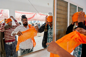 A group of young men tie their turbans to get ready for the Holla Mohalla.