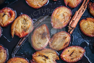 Roasted plums with vanilla and cinnamon in a baking dish