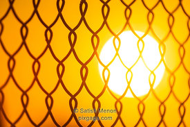Wired Fence and Sun at dusk, Alviso, CA, USA