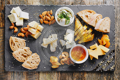 Elevated view of cheese platter served with ciabatta bread