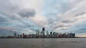 Wide Shot: Blankets Of Fluffy Nimbostratus Clouds Bring In An Electrifying Sunset Over Lower Manhattan