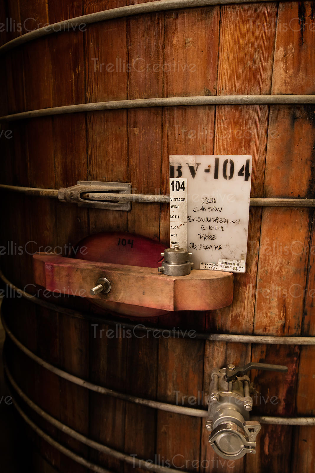 Close-up of a large old redwood wine barrel