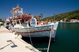 Fishing boat moored in Vathi harbour, Meganisi island, Lefkada, Ionian Islands, Greece.