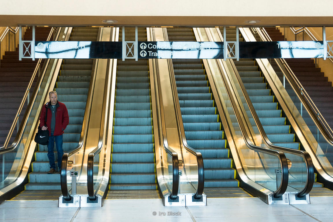 A commuter descends the escalator at Frank R Lautenberg Rail Station - Secaucus Junction in New Jersey.
