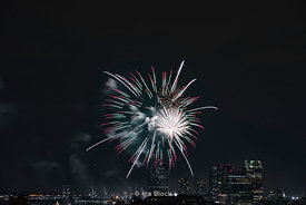 Fireworks over the Hudson River on Pride Day as seen from a rooftop in Chelsea, Manhattan.