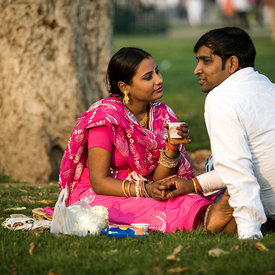 A couple hold hands in the park at India Gate. Public displays of affection are rare in a conservative city like Delhi. The parks and open spaces however are ofen full of romatic courting couples away from the prying eyes of traditional families