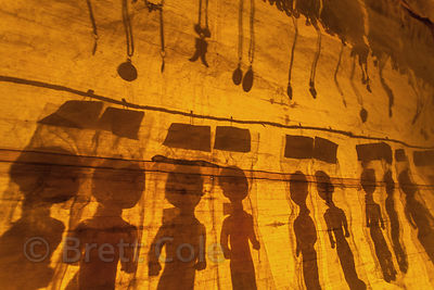 Silhouetted dolls are illuminated by a nightlight in a market stall that has closed for the night, at the 2013 Kumbh Mela, Allahabad, India.