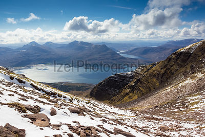 Looking out from the top of Coire nan Laogh on Ben Alligin, the summit of Sgurr na Bana Mhoraire, Loch Torridon and Loch Damh can all be clearly seen.