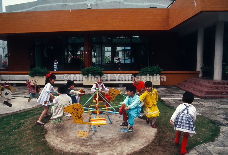 Children play during recess in Kindergarten. .Shekou, China.