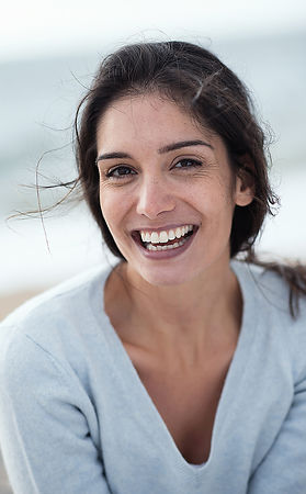 Portrait of a beautiful young brunette woman on the beach