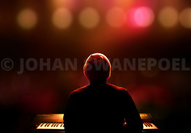 Pianist on stage from behind