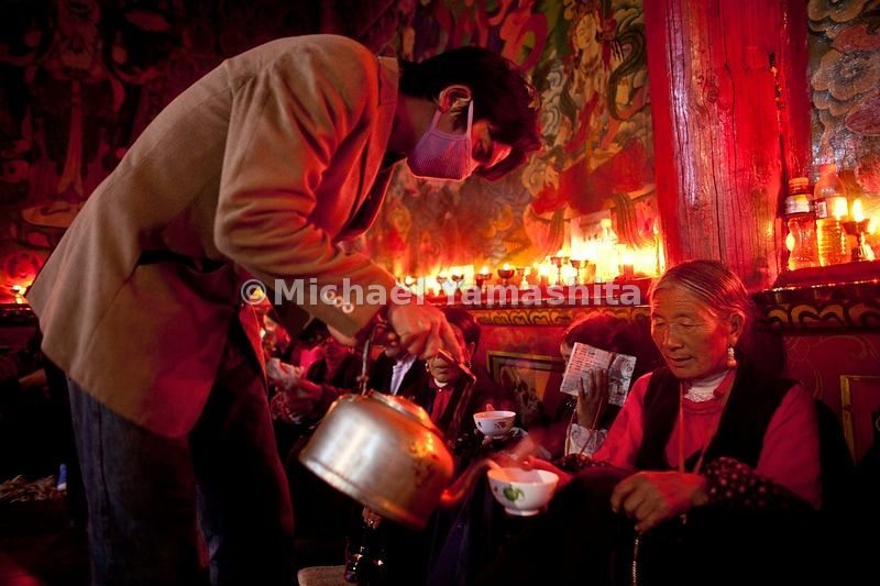 Tea is served to the local faithful who are participating in a 10-day festival at Garthar Monastery.