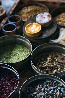 Rustic assortment of spices and ingredients at an old shop in Bundi, Rajasthan, India