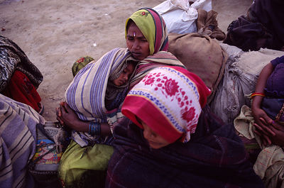 A mother and son wrapped against the early morning cold at the Ardh Kumbh Mela 1995, Allahbad, India