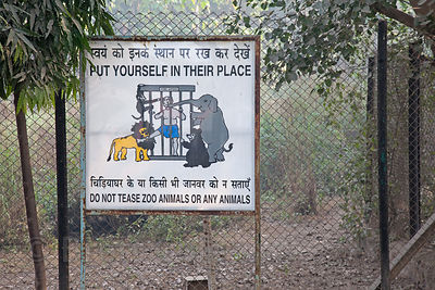 Sign asking visitors not to tease animals, National Zoo, Delhi, India