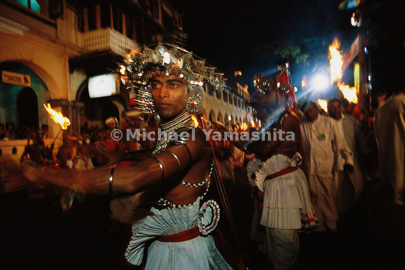 The Esala Perahera festival honoring the sacred tooth of Buddha is the largest and longest festival in Asia.  For ten days the tooth relic is paraded through the city streets atop an elephant to the accompaniment of drums and dancing. Kandy, Sri Lanka