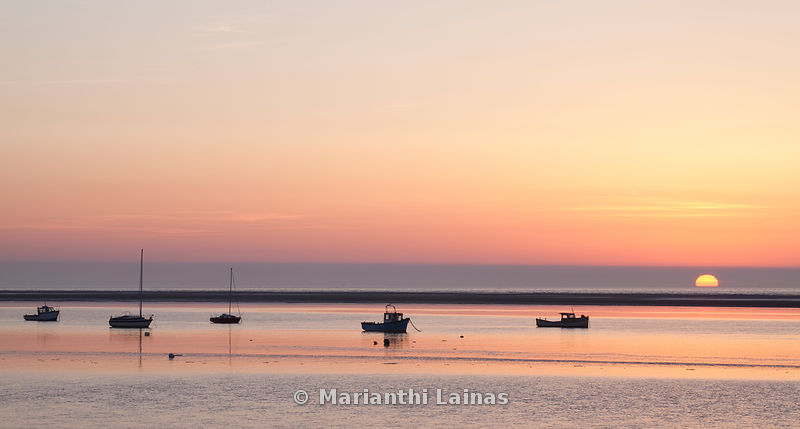 Boats at Meols at sunset