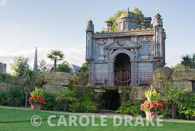 Oberon's Palace, a copy in oak of an Inigo Jones' design for a royal masque performed in Whitehall in 1611, recreated in the Collector Earl's Garden, designed by Julian and Isabel Bannerman. It sits atop a rockwork mountain and is surrounded by strongly architectural planting including palms, fatsias and cordylines. Arundel Castle Gardens, Arundel, West Sussex, UK